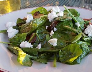 spinach salad with bacon, chevre, and mushrooms from Noonans Supper Club restaurant in Newport VT