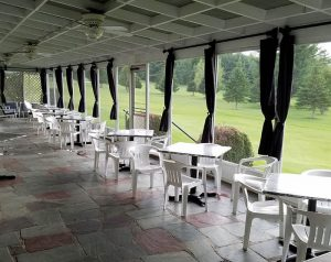 outdoor, screened in patio at Orleans Country Club restaurant, Orleans VT