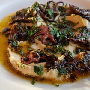 charred octopus dish from Noonan's Supper Club restaurant at the Newport Country Club