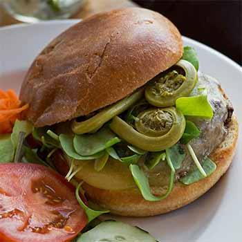 specialty burger with fiddleheads from the Hardwick Street Cafe restaurant in Greensboro