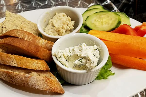 snack platter with cheese, hummus, and veggies