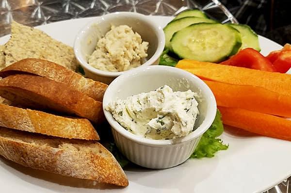snack platter with cheese, hummus, and veggies