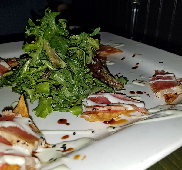 tuna carpaccio on chips as appetizer