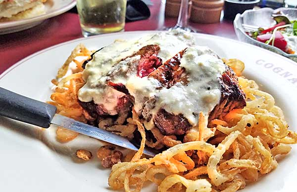 flank steak with blue cheese cream on bed of fried onions from Noonan's restaurant in Newport, Vt