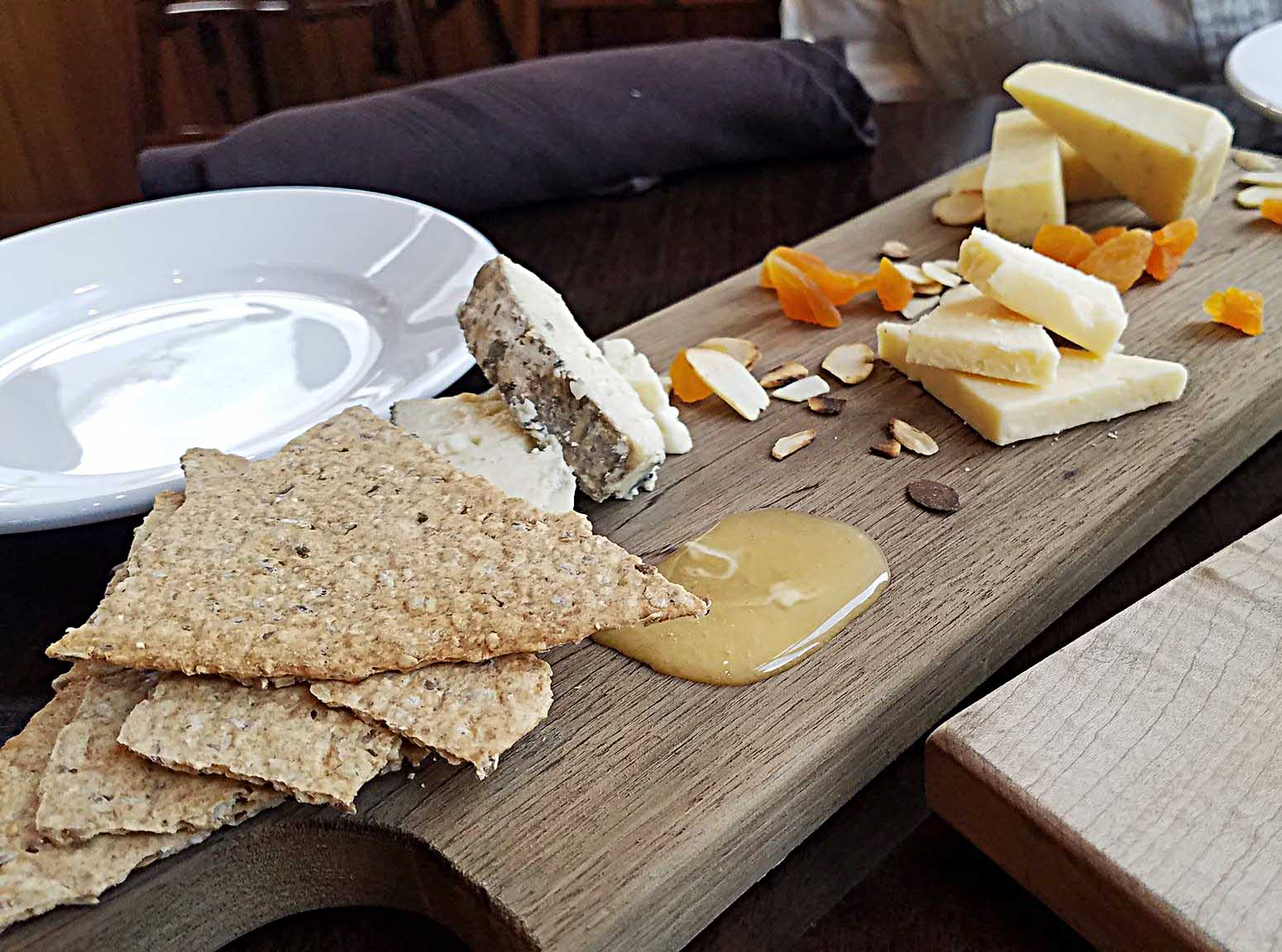 cheese plate with honey, fruits, and Vermont Cheese