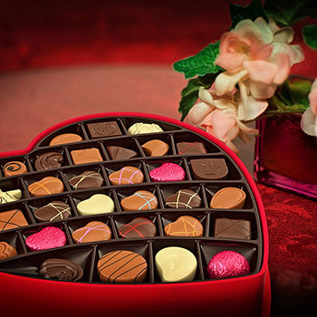 Valentine's Day chocolates and flowers for a romantic dinner